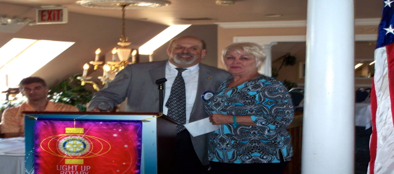 T.E.A.L. Accepts Check from South Shore Rotary